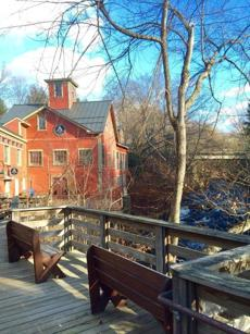 Benches on the boardwalk outside of the Montague Mill, which sits on the Sawmill River.